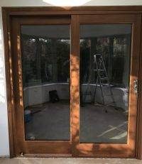 Sliding external wooden doors